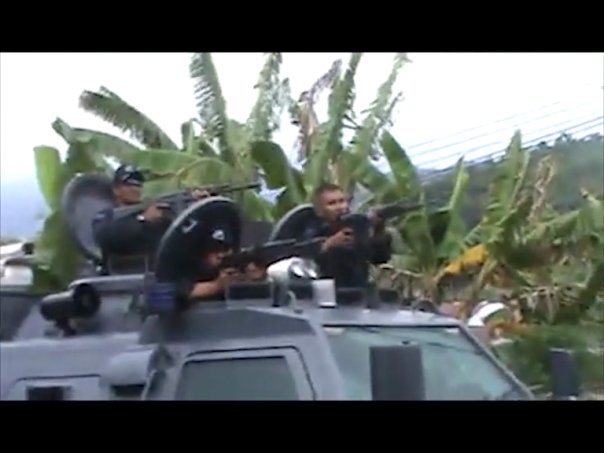 Detachment 88 troops firing live rounds at civilians during the brutal crackdown on the Third Papuan People's Congress, October 19, 2011 (West Papua Media video still)