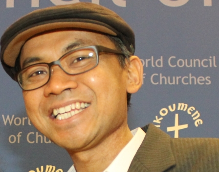 Muridan Widjodo at the International Coalition for Papua conference, World Council of Churches, Geneva, September 2013 (Photo: West Papua Media)
